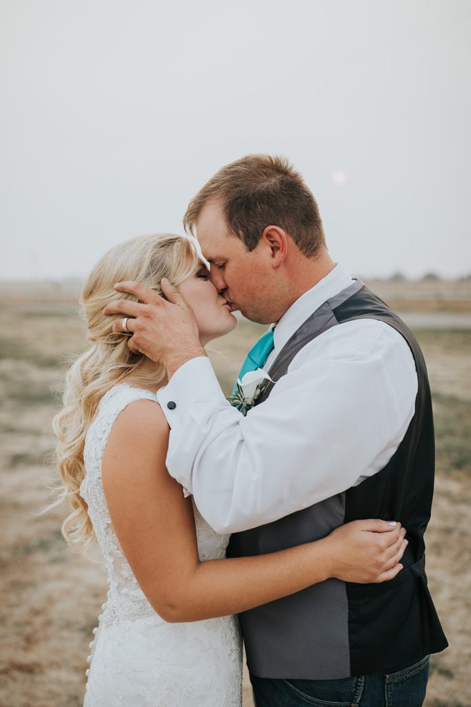 bride and groom kiss hazy wedding day medicine hat