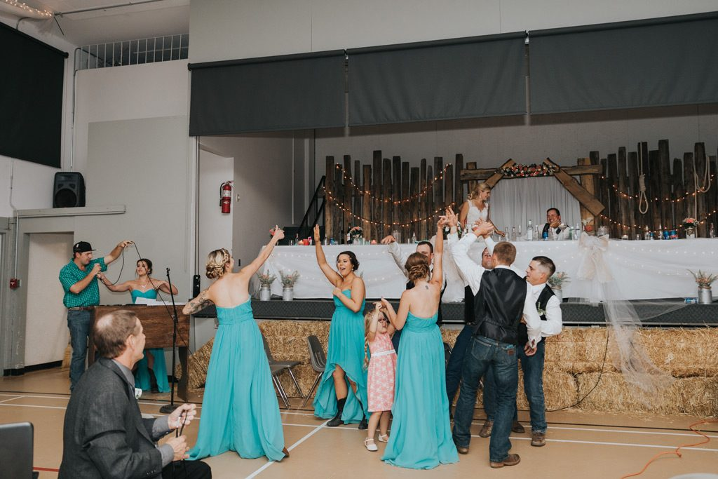 bridal party does surprise dance for married couple