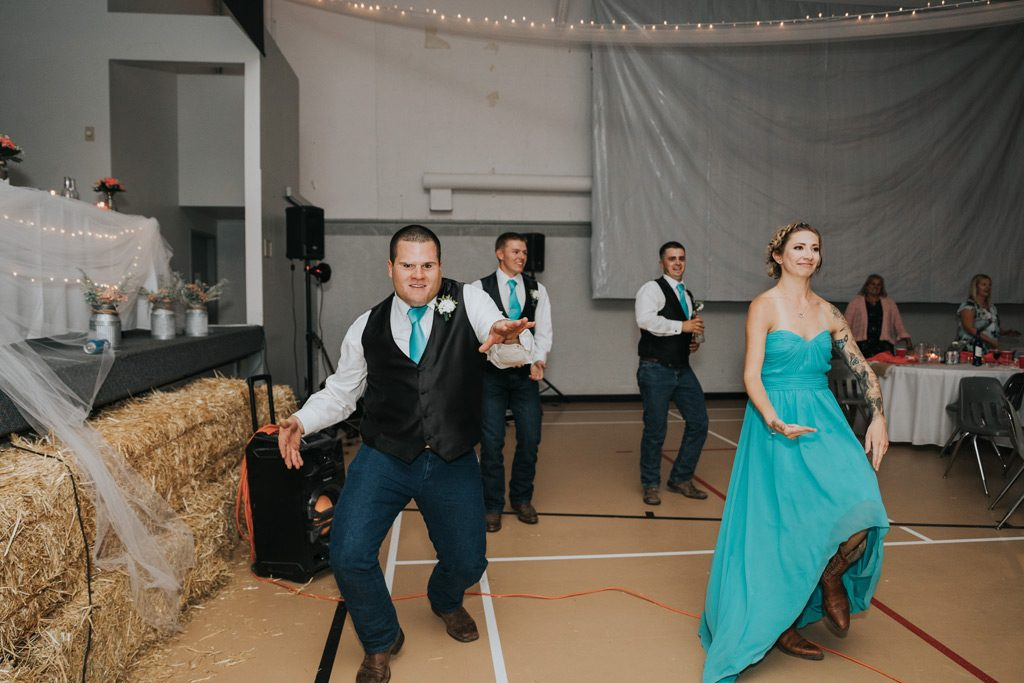 bridal party does surprise dance during wedding reception