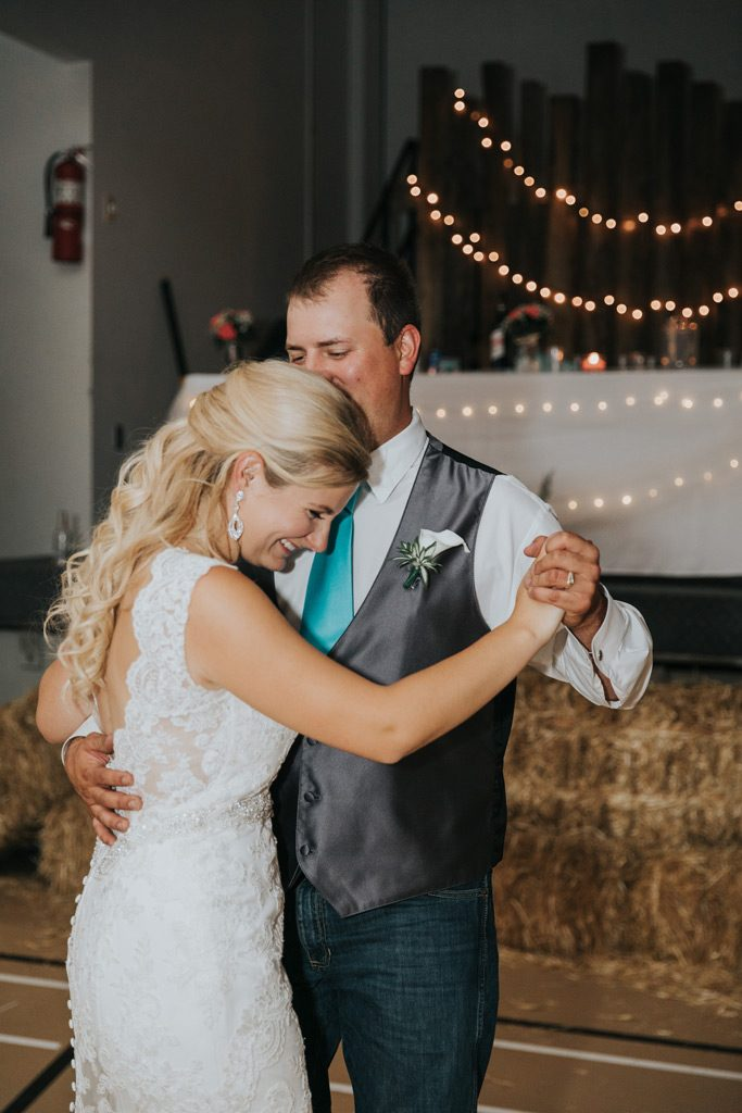bride laughs during first dance country wedding reception