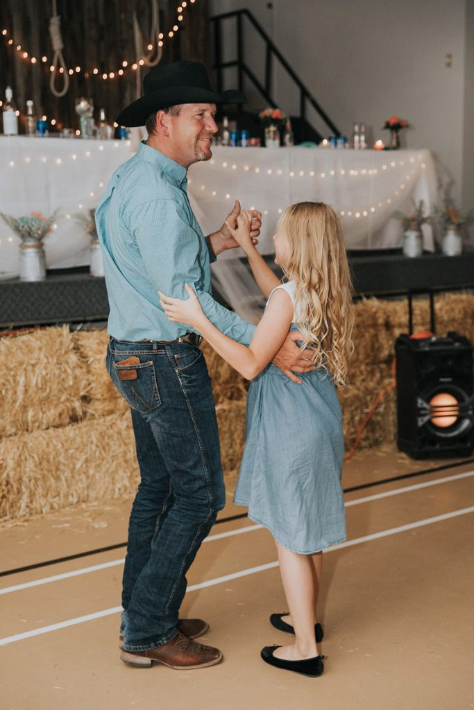 dad dances with daughter during wedding reception