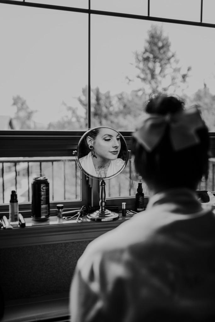 mirror shot bride doing her own makeup elkwater lodge