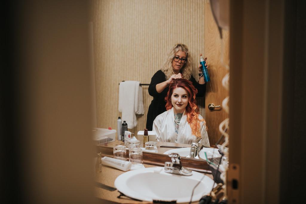 brides hair getting hairspray