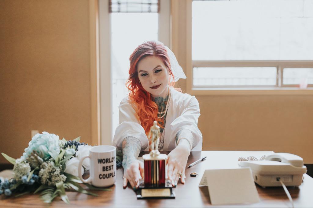 bride arranges trophy on desk like The Office