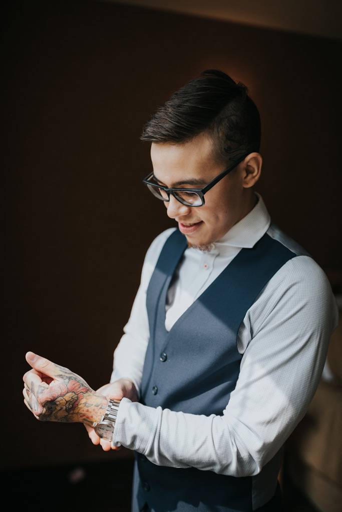 groom putting on his watch getting ready