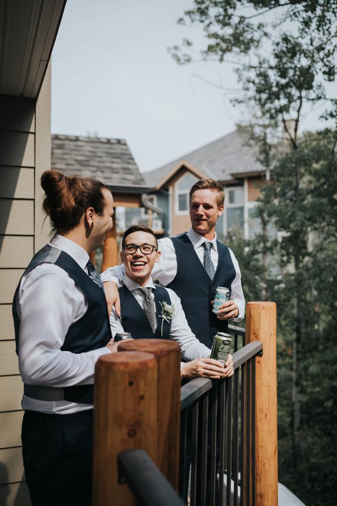 groom drinking with his groomsmen