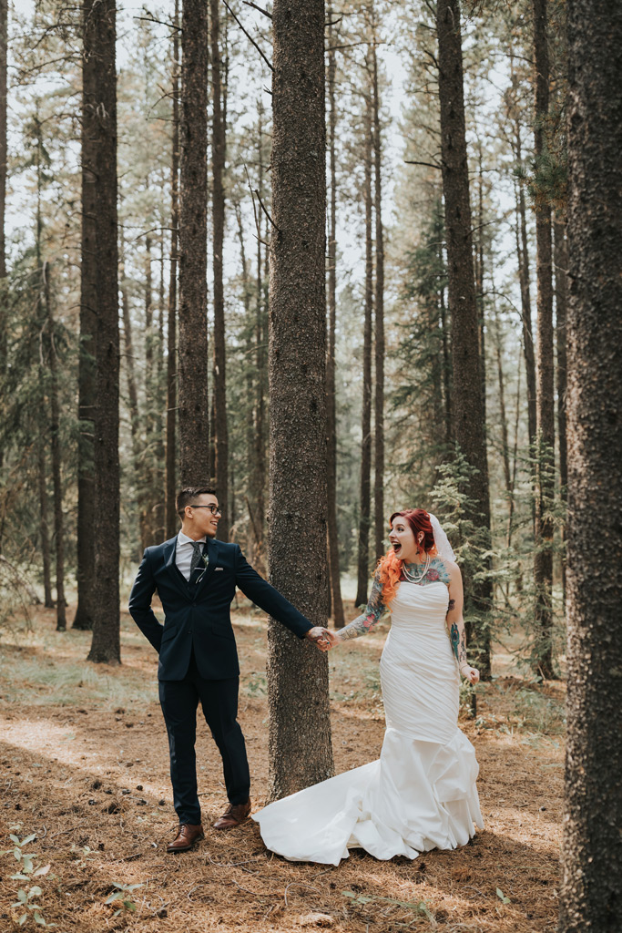elkwater forest wedding first look excited couple