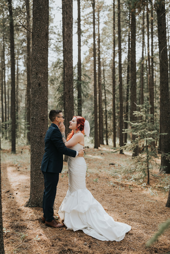 bride and groom look lovingly first look