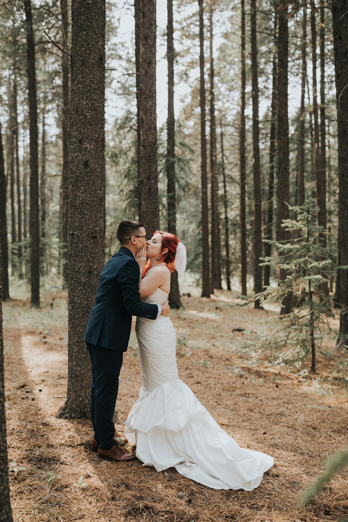bride and groom kissing first look
