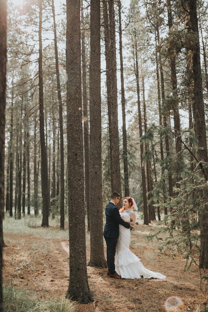 bride and groom first look elkwater wedding