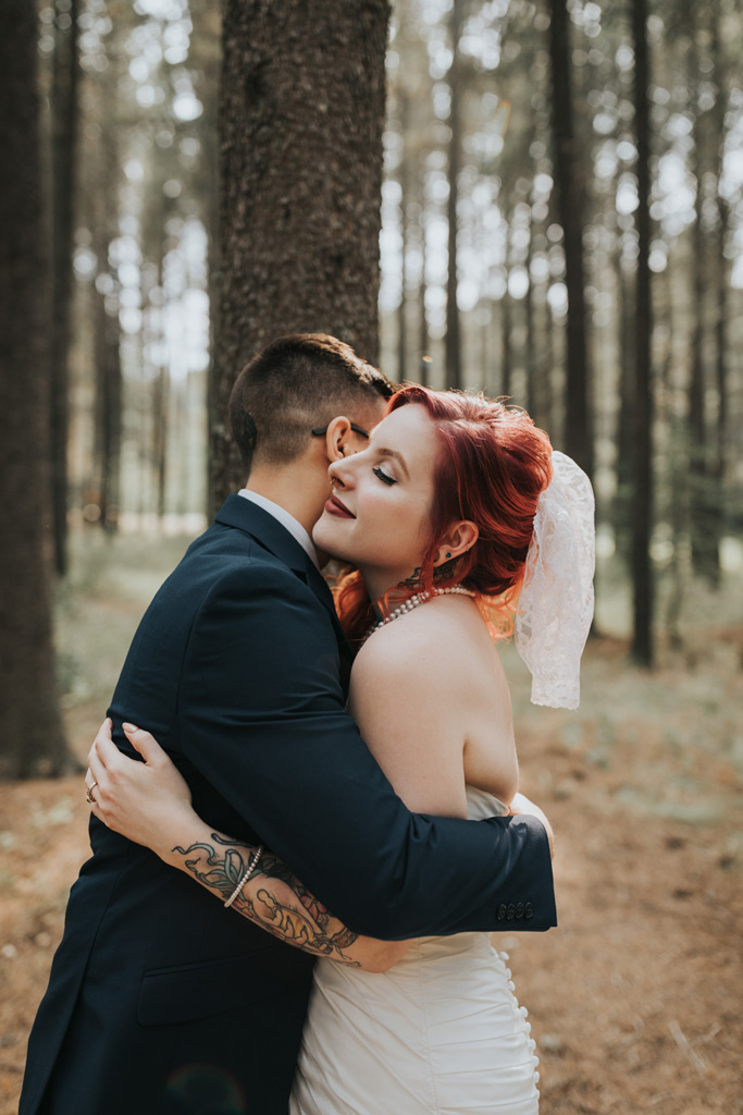 bride and groom embrace wedding first look