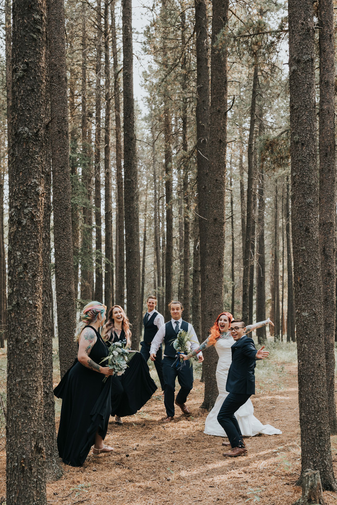 excited bridal party elkwater forest trees