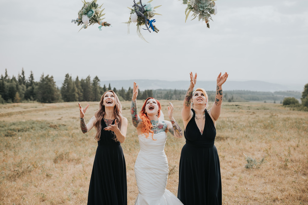 bridesmaids throw bouquets in the air