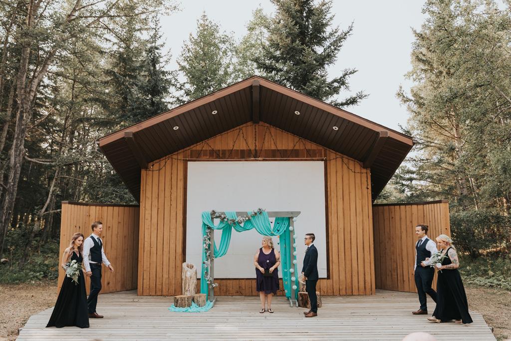 wedding ceremony bridal party walks down aisle