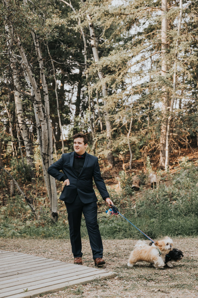 couples dogs being walked down aisle elkwater wedding