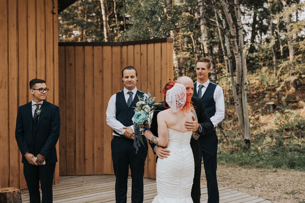 bride and dad hugging ceremony