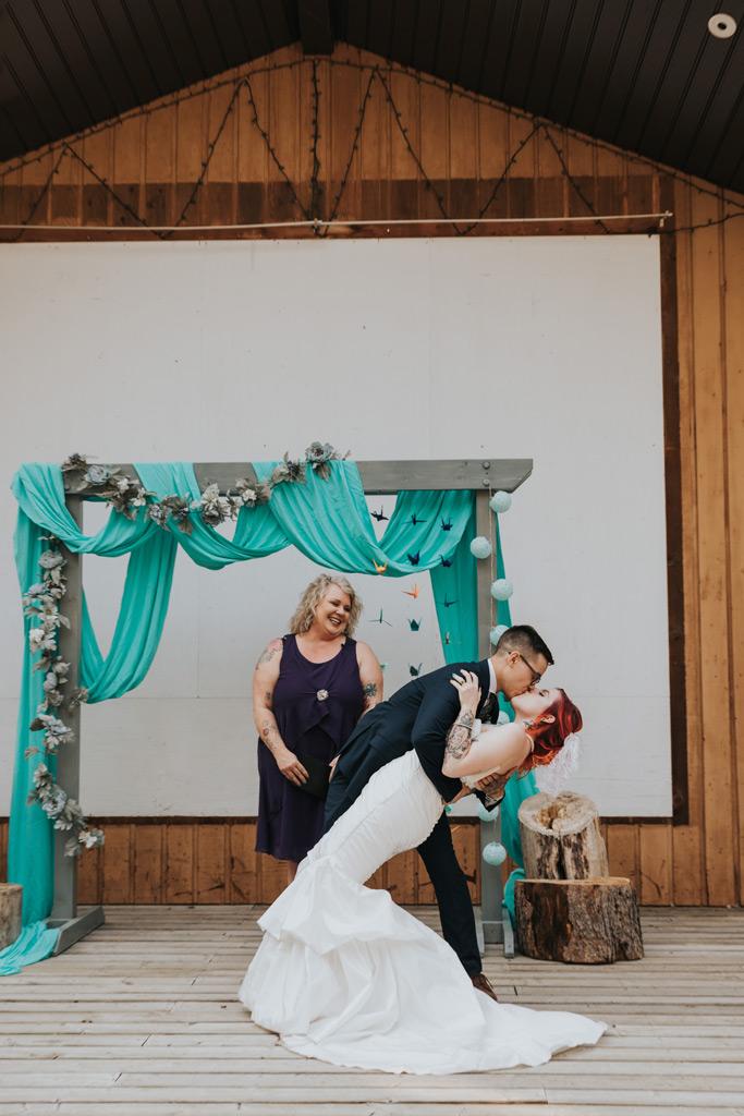 groom dips bride for kiss wedding ceremony