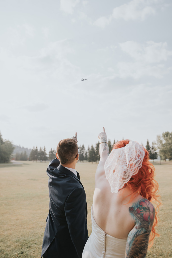 bride and groom point out helicopter elkwater