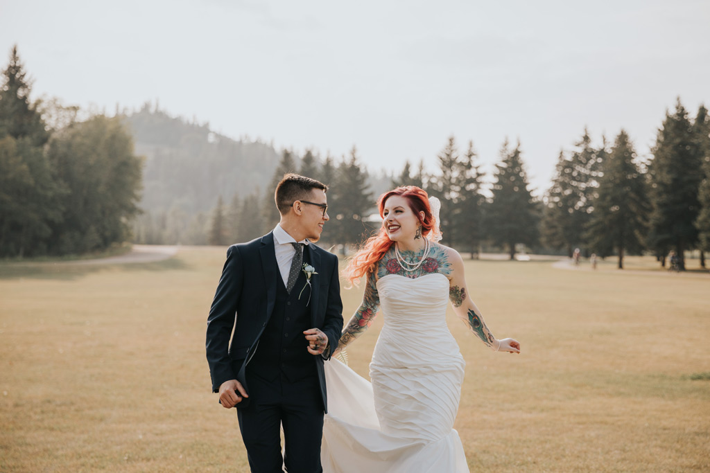 bride and groom laughing running elkwater