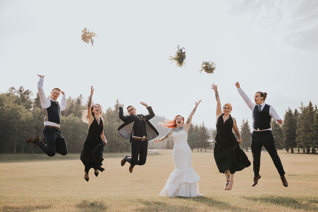 bridal party jumping throwing bouquets