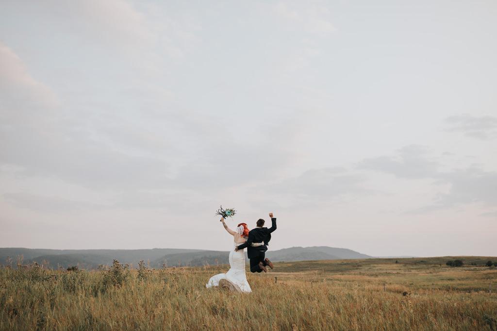 bride and groom jumping elkwater wedding