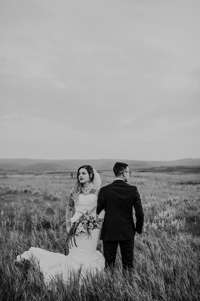 bride and groom stand facing opposite ways cypress hills