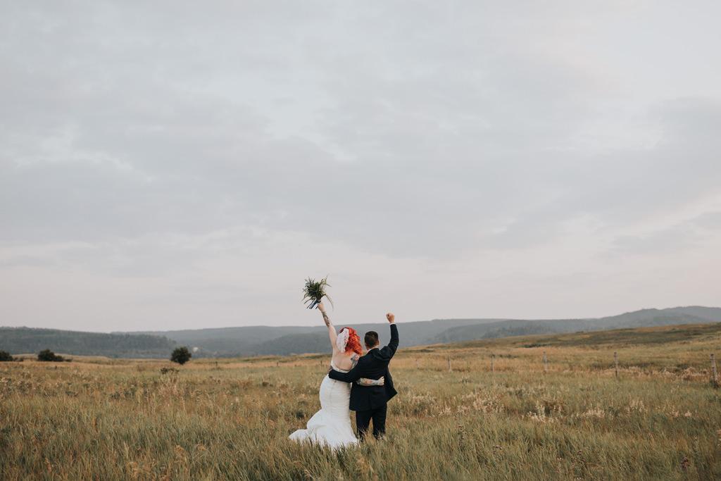 bride and groom cheers elkwater wedding