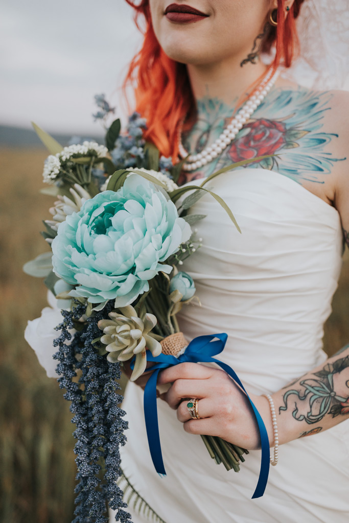 come up brides bouquet and rings