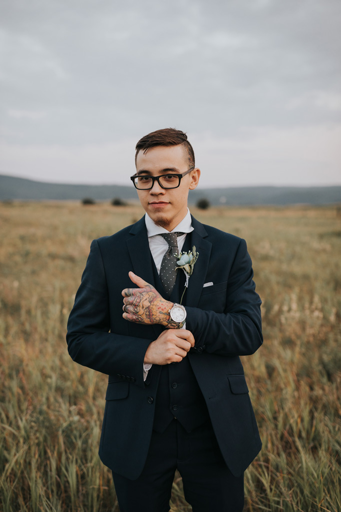 groom poses for portrait