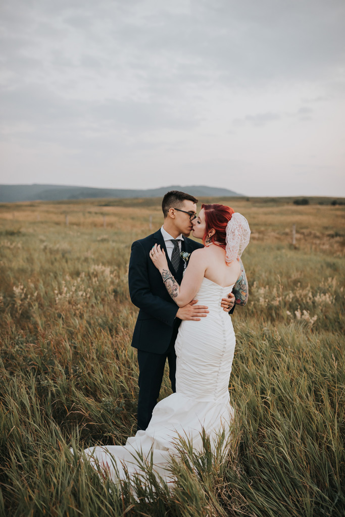 brie and groom about to kiss