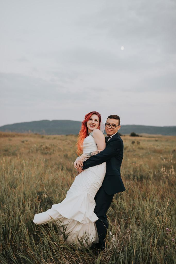 groom picks up bride spinning around