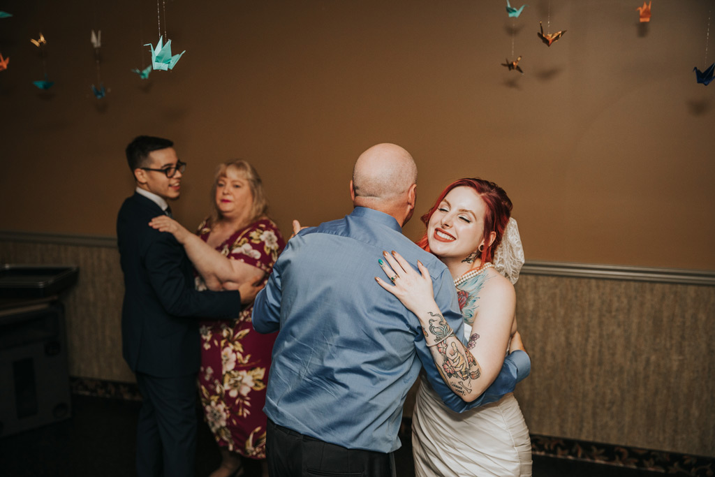 bride and groom parent dance reception