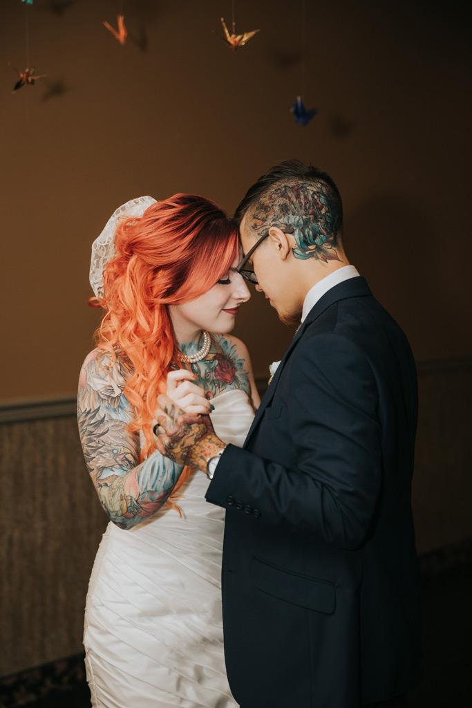 bride and groom dance close wedding reception