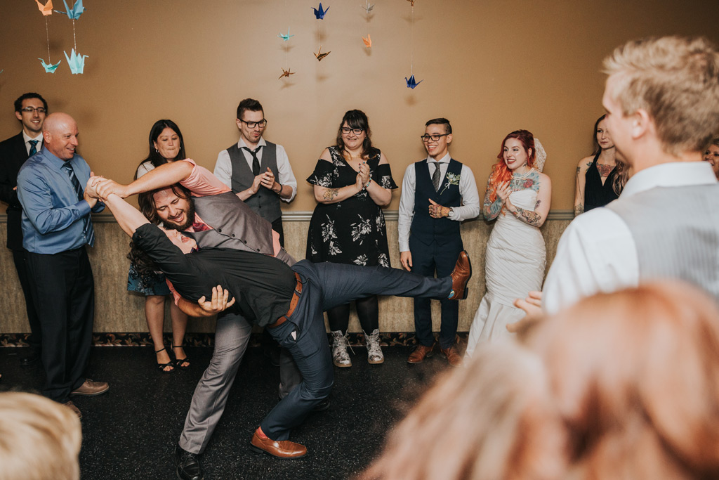 guests dancing wildly at elkwater reception