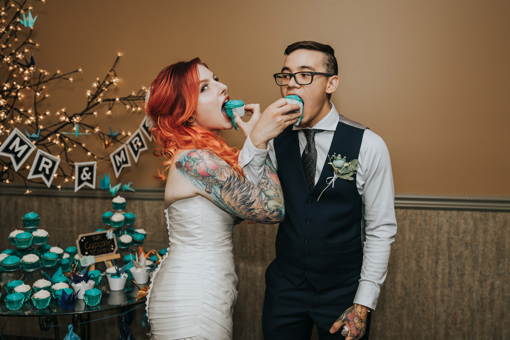 married couple eats cupcakes arms linked